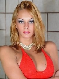 beatiful blonde tranny model posing at the home