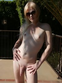 Blonde tranny is bathed in the warm pool